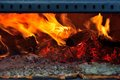 Pizza in a traditional italian fire place blazing fire burning red Stock Photos