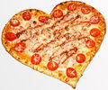 Pizza valentine s day fast food delicious food apetitnye view tomato meat mayonnaise dough for menu sausage heart favorite Royalty Free Stock Photos