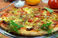 Pizza and vegetables. Royalty Free Stock Photography