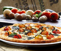 Pizza with vegetables roasted in the wood oven Stock Photos