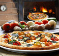 Pizza with vegetables roasted in the wood oven Stock Photography