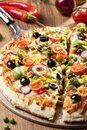 Pizza vegetarianSliced vegetarian pizza. Close-up on one piece. Royalty Free Stock Photo