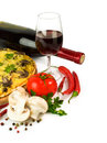Pizza with wine and ingredients Royalty Free Stock Photo