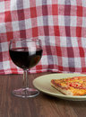 Pizza and wine piece of glass of Royalty Free Stock Photography