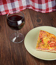 Pizza and wine piece of glass of Stock Photo