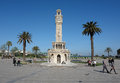 Place with clocktower in izmir and palms morning Royalty Free Stock Image