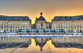 Place de la Bourse reflecting from the water mirror in Bordeaux, France Royalty Free Stock Photo