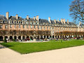 Place des Vosges in Paris in the spring sunny day