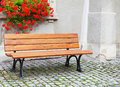 Place of rest bench wooden on a house Stock Photo