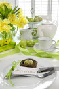 Place setting with card for easter brunch Royalty Free Stock Photo