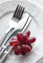Place setting with fresh grapes Royalty Free Stock Photo