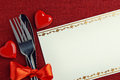 Place setting with red heart shapes Stock Image