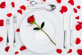 Place setting with red rose and petals Stock Image