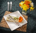 Place setting with spring flowers Royalty Free Stock Photo