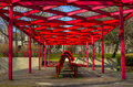Place to relax modern red structure over the sitting in the city Royalty Free Stock Image