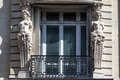 Place vendome paris two female sculptures adornments on a window of a historical building in france Royalty Free Stock Photo