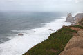 Place where the sea meets the land. High cliffs. Big waves and gusty winds. Cabo da Roca - rainy day. Royalty Free Stock Photo