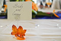 Placement card for the groom and bride at a party seating on table wedding Stock Photography