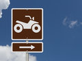 Places to ride atv an american road sign with a symbol of an and sky Royalty Free Stock Photos