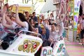 Plaerrer, Augsburg Germany, APRIL 22, 2019: young families enjoying their time with kids in a carnival ride