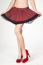 Plaid skirt and red heels woman s legs wearing a Stock Photos