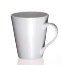Plain coffee cup an white reflects on a white surface Royalty Free Stock Image