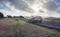Plain field with a car along one road leading to apostles parked my to shoot this Royalty Free Stock Photography