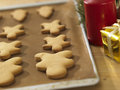 Plain gingerbread man on the tray Stock Image