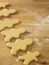 Plain gingerbread man uncook on table Stock Photos