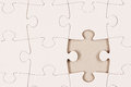 Plain white jigsaw puzzle with piece missing Royalty Free Stock Photography