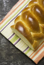 Plaited bread on a baking tray and tea towel Stock Image