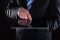 Plan rapproché d homme d affaires using digital tablet Photographie stock
