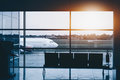 Plane in airport near. View from indoor Royalty Free Stock Photo