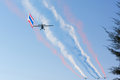 The plane color smoke emissions Royalty Free Stock Photo