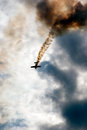 Plane on fire low angle view of in cloudy sky Stock Photography