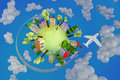 Plane flies planet with flowers painted houses and a Royalty Free Stock Photography