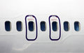 Plane fuselage with emergency exit Stock Photography