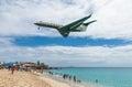 Plane landing flying over famous Maho Beach