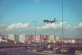 Plane landing over freeway Royalty Free Stock Photo