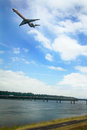 Plane over i bridge to government island a flys the glenn jackson memorial connecting oregon and then on washington state Stock Photography