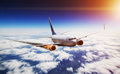 Plane in the sky with engine on fire Royalty Free Stock Photo