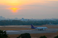 The plane takeoff in morning Stock Image