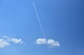 Plane Trail on a Blue Sky Royalty Free Stock Photo