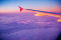 Plane wing at sunset Royalty Free Stock Photo