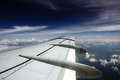Plane wing view in flight Royalty Free Stock Images