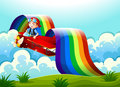 A plane with a young boy and a rainbow in the sky Royalty Free Stock Photo