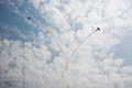 Planes in air stunt show an leaving smoke trail Royalty Free Stock Photo
