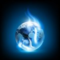 Planet earth and blue flames vector image Stock Photography