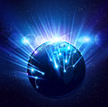 Planet earth in the bright rays of light Royalty Free Stock Photos