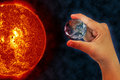 Planet earth in the hand with sun burn elements of this image furnished by nasa http www nasa gov Royalty Free Stock Image